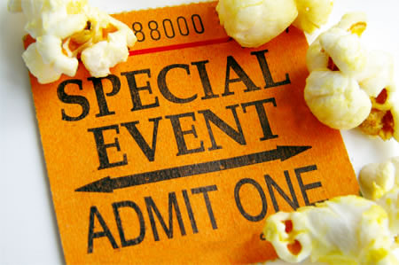 Image of a paper admission ticket surrounded by pieces of popcorn.
