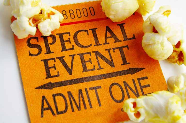 "A ""special event"" ticket, with a few pieces of popcorn."